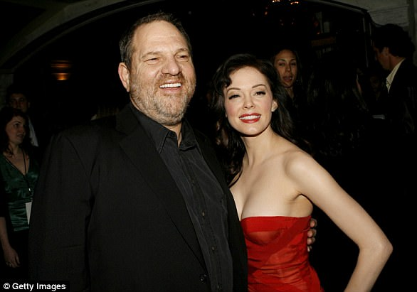 """Producer Harvey Weinstein (left) and actress Rose McGowan arrive to the premiere of """"Grindhouse"""" at the Orpheum Theatre on March 26, 2007 in Los Angeles"""