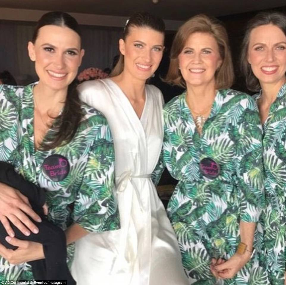 Again! Michelle, a Brazilian model, originally married Guy back in 2006 but the two decided to renew their vows. She is pictured here with her sisters and mother