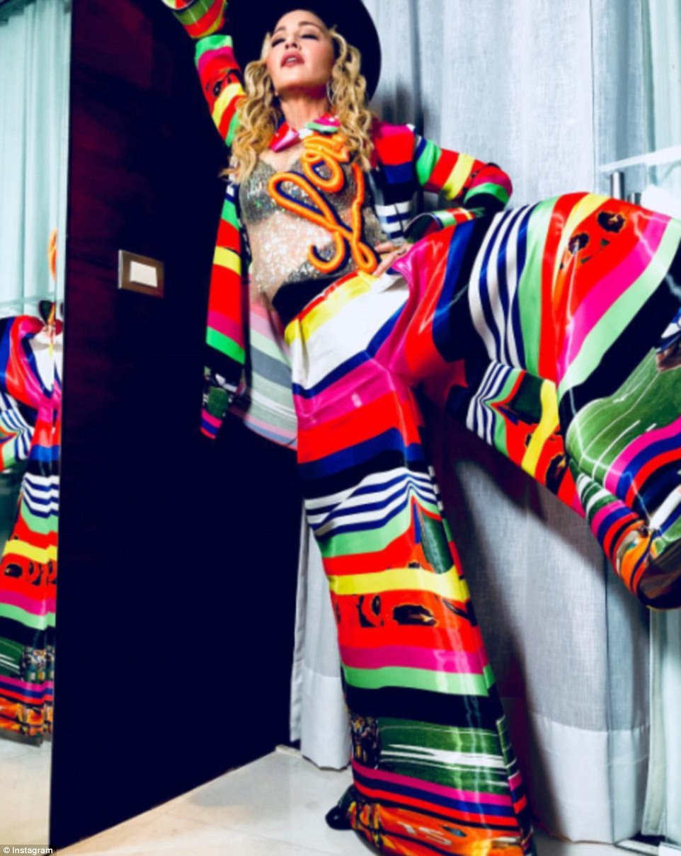 'Blame is on Rio': Madonna posted a snap of herself in a brightly colored outfit at the pre-party on Monday