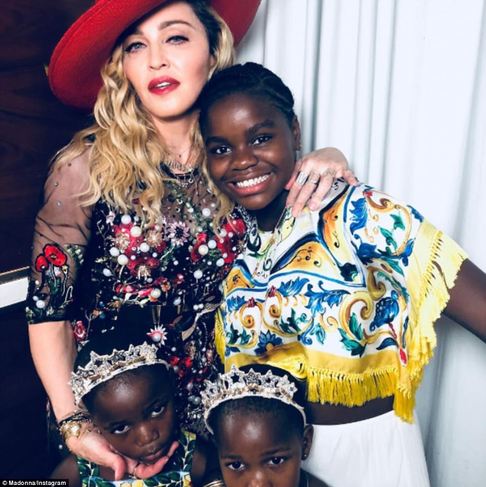 Family affair: Madonna even brought three of her kids along and shared a cute snap with Mercy,Stelle and Estere online