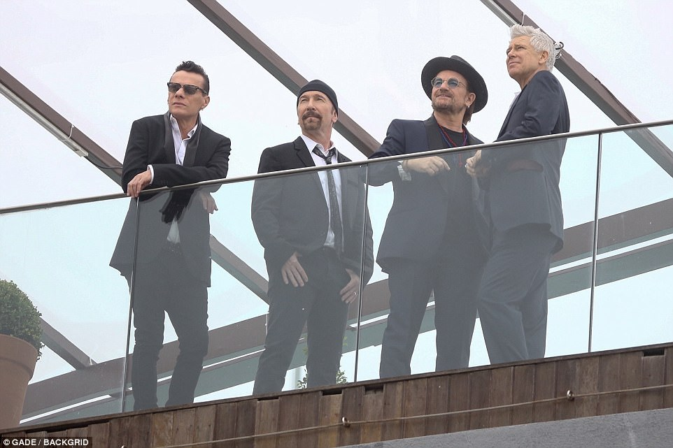 Bono, the Edge, Adam Clayton and Larry Mullen Jr. pose during a photoshoot on the roof of the Fasano Hotel ahead of their manager's, Guy Oseary, wedding