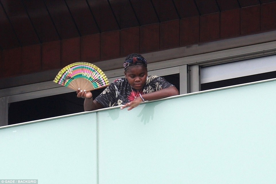 Madonna's adopted 11-year-old daughter, Mercy James, looked down from the balcony at the star-studded event