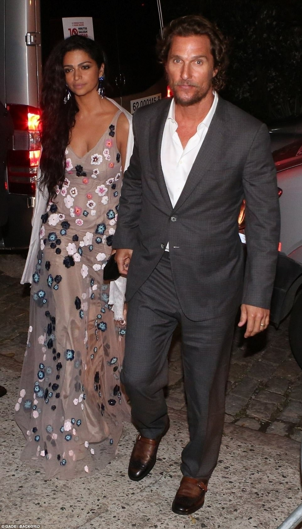 A-list couple: Oscar winner Matthew, 47, was accompanied by his Brazilian wife Camila Alves, whowore a diaphanous sleeveless gown with floral detailing and a plunging neckline