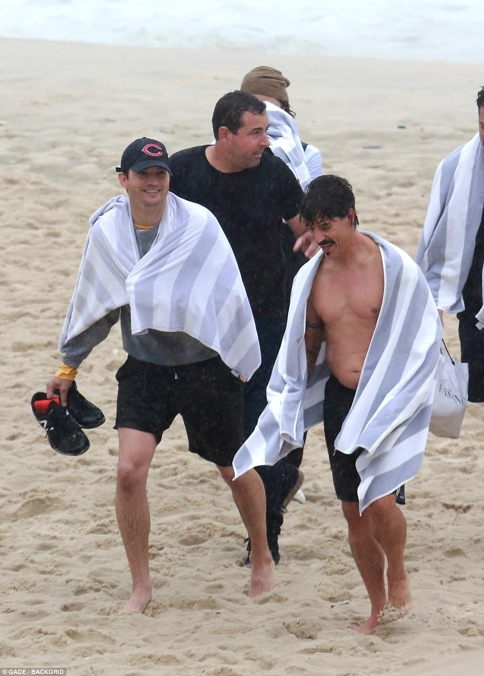 That's enough: Ashton, Anthony and the gang towelled off as they left the beach