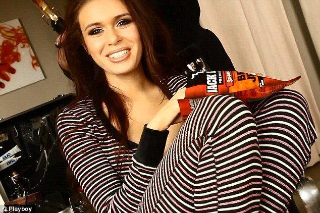 Model behavior: Miss Deweese relaxes and eats beef jerky in between modeling for Playboy's 'coed of the month' in 2011