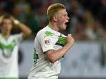 Wolfburg's Kevin De Bruyne from Belgium gestures to the referee during the German Supercup final soccer match between VfL Wolfsburg and Bayern Munich in Wolfsburg, Germany, Saturday, Aug. 1, 2015. (AP Photo/Martin Meissner)