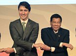 President Duterte said he was angered and insulted yesterday after Prime Minister Trudeau spoke about his government's war on drugs, which has been widely condemned for leaving thousands of suspects dead. Pictured: The two leaders holding hands yesterday