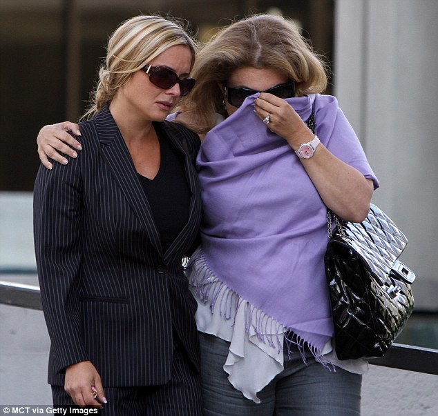 Emotional: Kimberly Rothstein, left, who insists she knew nothing about her husband's criminal dealings, walks out of the federal courthouse in Fort Lauderdale, Florida, after he was sentenced to 50 years in prison
