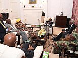 This is the first picture of Robert Mugabe (back centre) after he was placed under house arrest in a military coup - amid claims he is refusing to step down as Zimbabwe's president. Also in the room, is military chief General Constantino Chiwenga (in fatigues), defence minister Sydney Sekerayami (to Mugabe's left), State Security Minister Kembo Mohadi (red tie) and South African politician Nosiviwe Mapisa-Nqakula (yellow head wear)