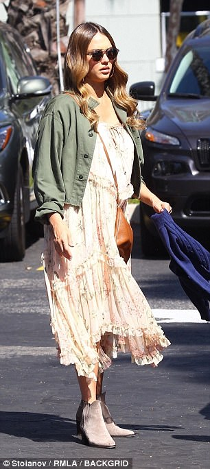Army brat! Jessica, known for her exquisite feminine style, layered a floral, prairie dress underneath an army green bolero jacket