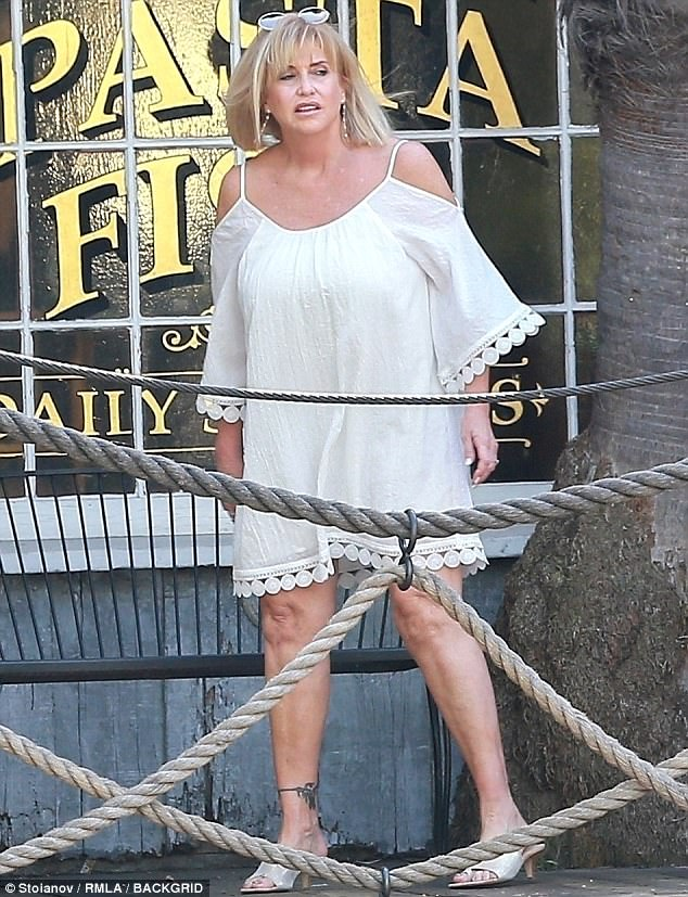 Birthday outfit: Cathy wore an off-the-shoulder, white dress and kitten heels