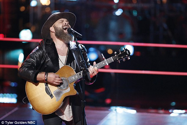 Big voice: Guitar-playing Adam belted out his part