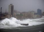 FILE - In this Sept. 9, 2017 file photo, strong waves brought by Hurricane Irma hit the Malecon seawall in Havana, Cuba. The elegant, seaside boulevard, where early 20th-century buildings are pounded with massive waves during storms and cold fronts, is now being pushed toward collapse by rising seas, more intense hurricanes, and decades of neglect. (AP Photo/Ramon Espinosa, File)
