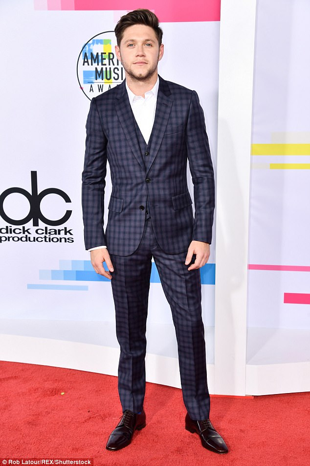 Dapper: Niall Horan, 24, looked dapper in a three-piece Paul Smith suit as he graced the red carpet at the American Music Awards in Los Angeles on Sunday