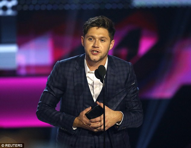 Speech! The former One Direction star looked slick in a patterned suit