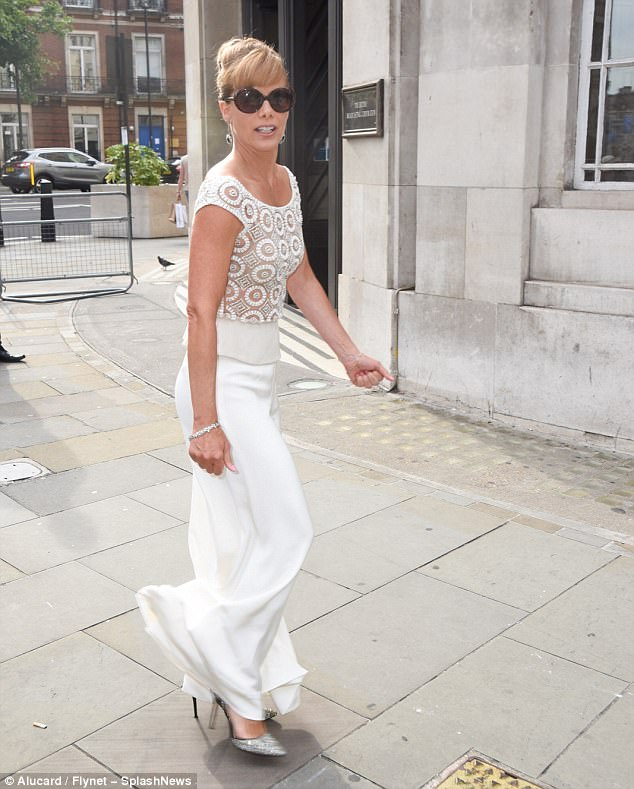 Stunning: Bussell had her hair styled in a chignon and she shielded herself from the sunny rays with a pair of shades