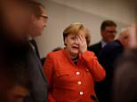 German Chancellor Angela Merkel is pictured today after her three-way coalition talks collapsed