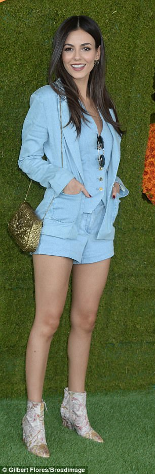 Legs for days: Victoria, 24, flashed her toned legs in tiny denim shorts, adding a matching waistcoat and blazer