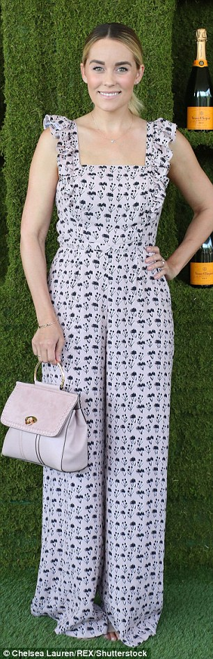 Strike a pose:  New mom Lauren Conrad, 31, wowed in her lavender and black jumper with a coordinating handbag for the event
