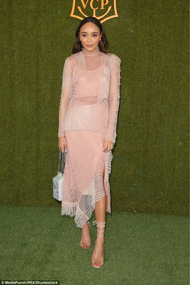 What an incredible look: Ashley Madekwe cut a stylish figure in her sheer pink and white dress with a Chanel clutch