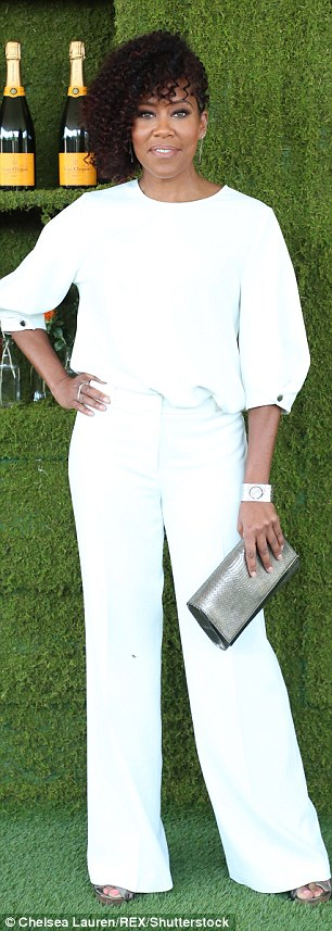 Classic: Regina King and Abigail Spencer both chose white ensembles with unique clutches