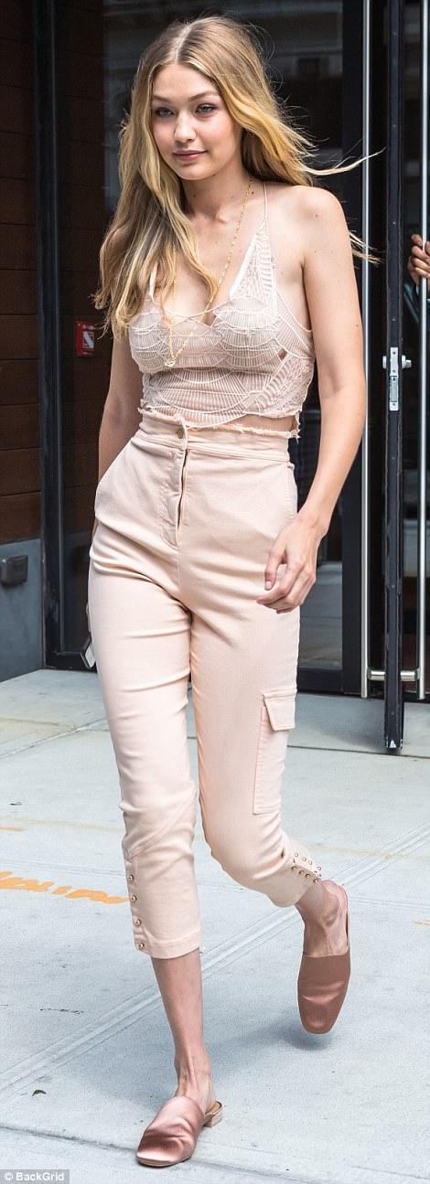 Sartorially savvy:Opting for a pair of high-waisted cropped jeans that sheathed her pins, Gigi sported an intricate bodice on top that boasted dainty spaghetti straps and coyly hidden cut-outs that teased a look at the starlet's cleavage underneath