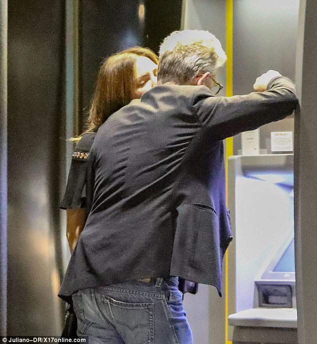 Steamy:David Foster, 67, was spotted getting a smooch on his cheek from the Katharine McPhee, 33, while stopping at an ATM machine in Brentwood on Sunday