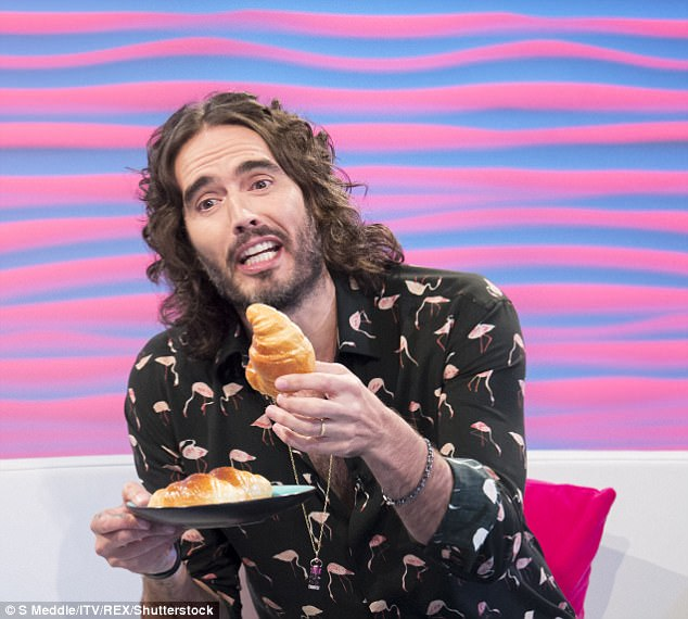 Russell Brand complains he is living hand-to-mouth - despite being worth an estimated £10m