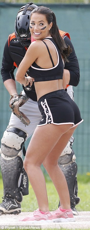 Hit 'em high: While her monochrome printed hotpants showcased her perky derriere, Yazmin's choice of ensemble highlighted her taut stomach as she got active for the afternoon of filming