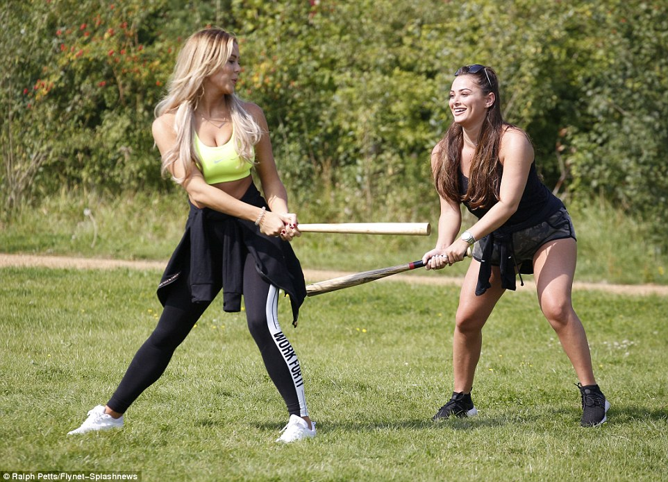 Joking around: Chloe and Courtney pretended to whack each other with bats