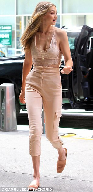 Top of the crops: The supermodel was pictured leaving the Victoria's Secret offices in New York City after a fitting on Monday morning