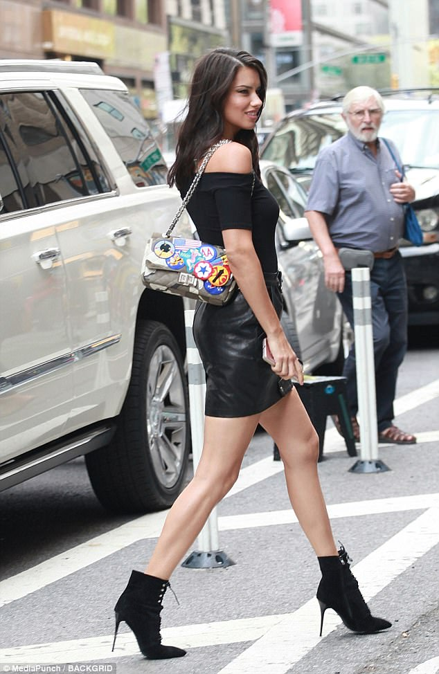 Pins on parade: Adriana looked incredible in a leather mini-skirt and killer heels
