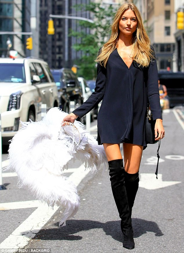 Strutting her stuff: Martha Hunt paraded through the streets of Manhattan with her Angel wings after attending a morning of fittings