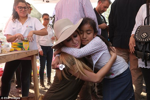 Good deed: In November she helped deliver aid and pledged to build new houses in the earthquake-struck Mexican region of Xochimilco