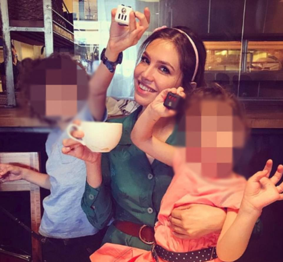 Signs of split? Dasha wasn't wearing a wedding ring when she posed for this photograph while drinking coffee on June 8