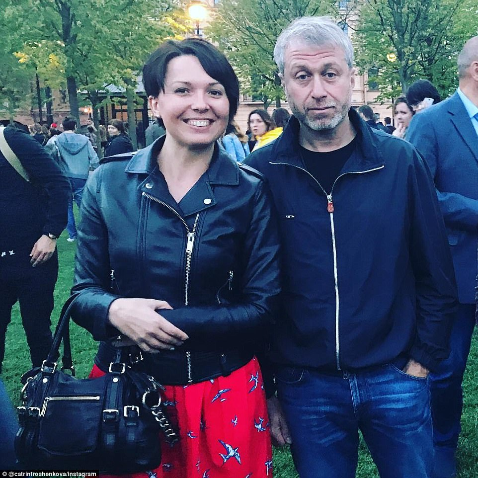 Smile for the camera: The couple's announcement came one week after Roman attended a social event in St. Petersburg without Dasha, as locals took selfies with the billionaire