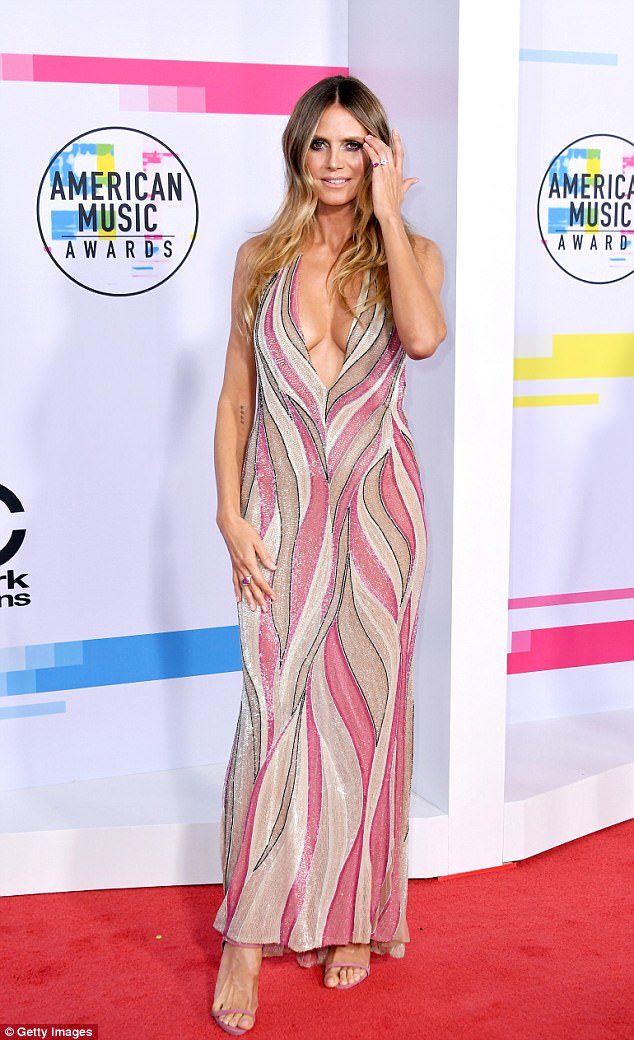 Stunning: Heidi showed off an ample amount of cleavage as the dress plunged down to nearly reveal her navel