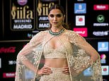 """FILE - In this June 25, 2016 file photo, Bollywood actress Deepika Padukone poses for photographers at the International Indian Film Academy Rocks Green Carpet for the 17th Edition of IIFA Weekend & Awards in Madrid, Spain. A member of India's Hindu nationalist ruling party has offered a 100 million rupee ($1.5 million) reward to anyone who beheads the lead actress Padukone and  Sanjay Leela Bhansali, the director of the yet-to-be released Bollywood film """"Padmavati"""" over its alleged handling of the relationship between a Hindu queen and a Muslim ruler.  The film's producers postponed the release of the film, which was set to be in theaters Dec. 1, 2017. (AP Photo/Samuel de Roman, File)"""
