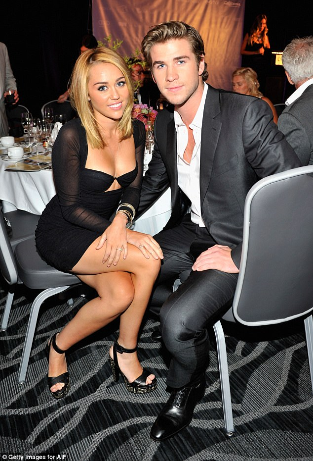 Smitten: Liam is pictured with Miley in 2012