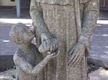 Blackfriars Priory School's new statue of a saint handing a loaf of bread to a young boy was perhaps a half-baked idea