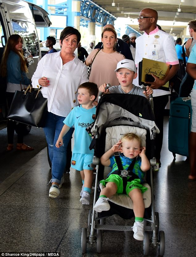 Family holiday: Coleen was joined at the airport by her mother Colette and her three children; Kai, Klay and Kit