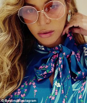 Sultry: She had stunning pear drop diamond earrings and sported a pair of large rose-tinted sunglasses