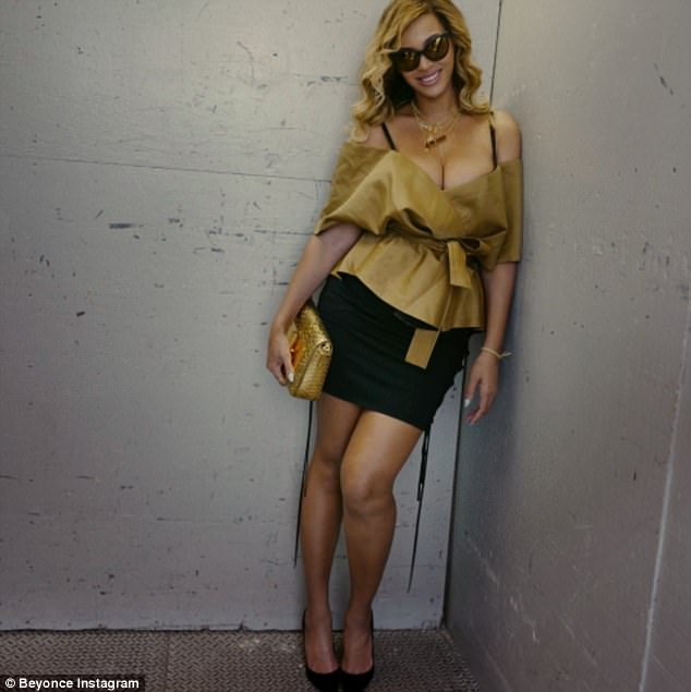 Having fun: She added a black mini skirt and black pumps with a gold clutch