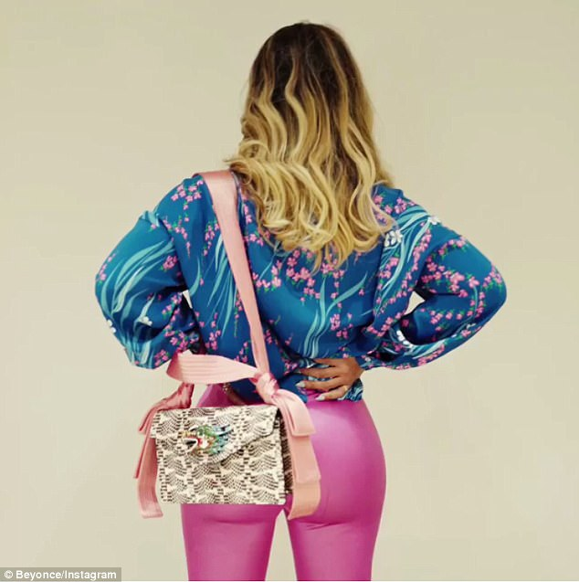 Flaunting it: Her rear view was impressive as she smouldered in the clip