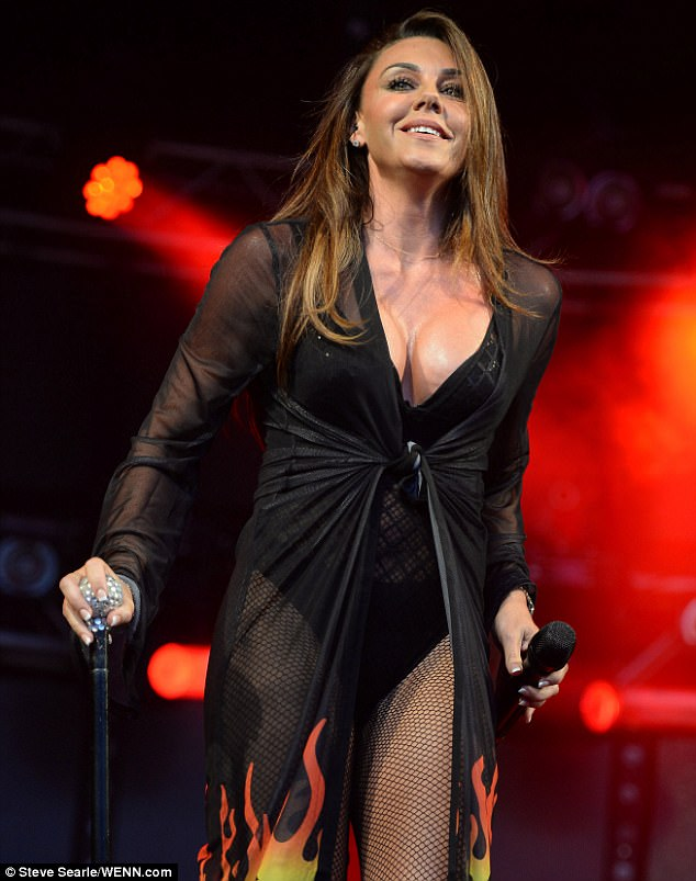 She's flaming hot: Joining Jessica Taylor and Kelli Young onstage, the 38-year-old singer oozed sex appeal when her eye-popping cleavage was on show in a daring leotard