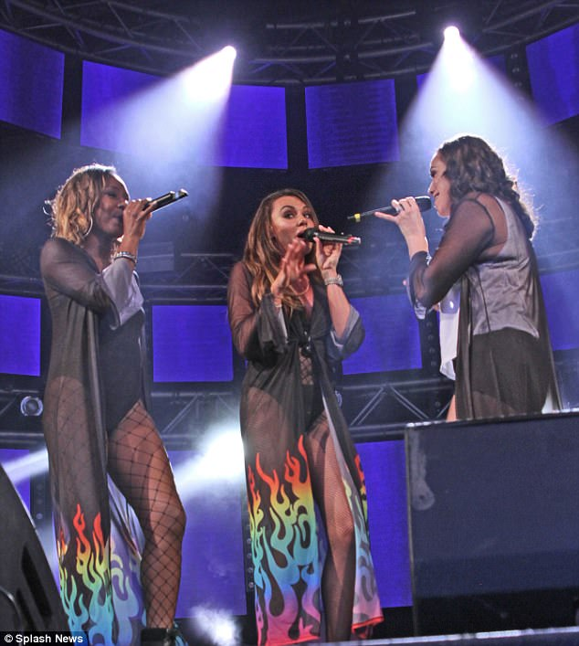Bringing it back!The pop princess was in her element, joined by her fellow girl band members Jessica Taylor and Kelli Young (left)