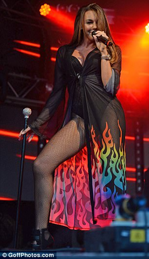 Red hot: The hitmaker got fans hot under the collar in the skimpy attire