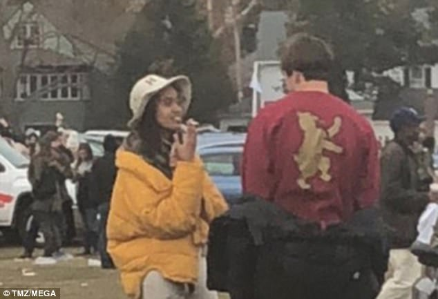In another photo, Malia is smoking what appears to be a cigarette