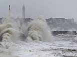 High tides and strong winds gusting at up to 50mph bring large waves against the coast of Cleveleys in Lancashire today