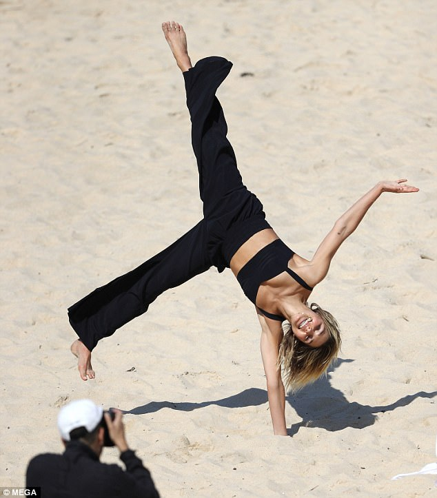Gymnastic fantastic: The pants seemed to offer the model plenty of freedom as she burst out into some light acrobatics in the sand
